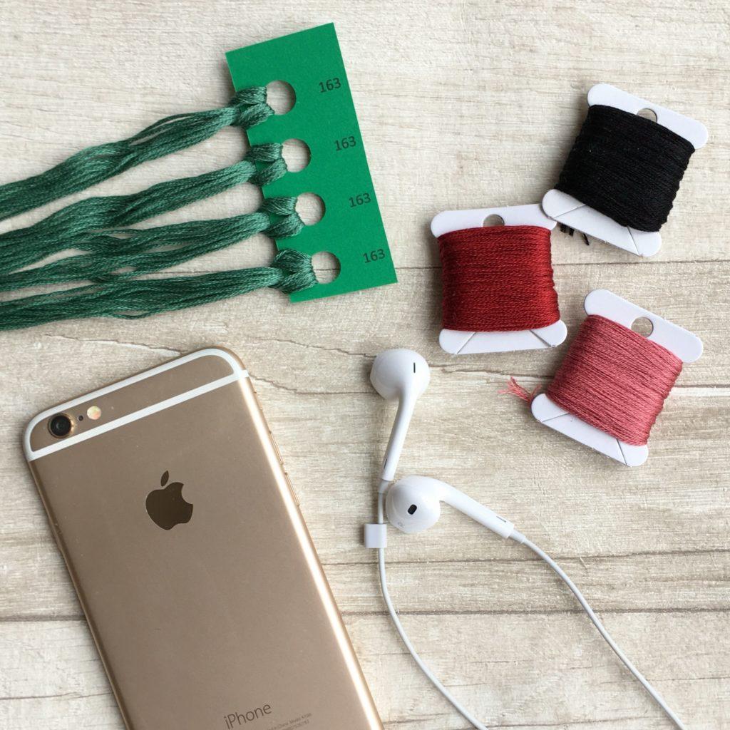 embroidery-thread-phone-and-headphones-flatlay