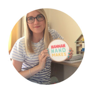 hannah-hand-makes-holding-cross-stitch-hoop