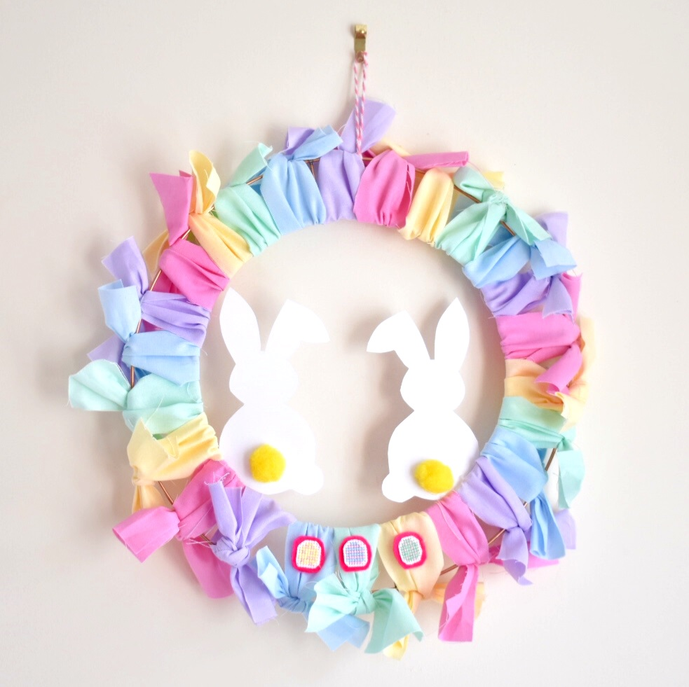 finished-diy-easter-wreath-hanging-up-on-wall